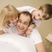 Dad & kids playing in bedroom